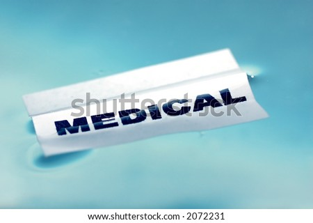 Card floating on water surface with printed word: MEDICAL