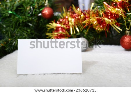 card frame with fir branches with New Year's toys on a white wooden background toning