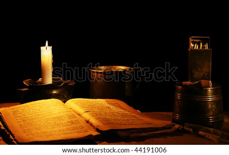 Card from the past: reading at a candle - stock photo