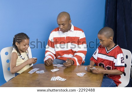 Card game at the dinner table - stock photo