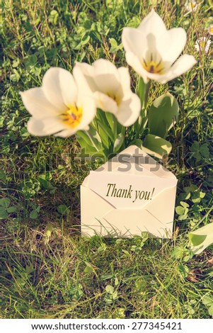 Card in envelope saying Thank You! - stock photo