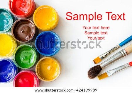 card of paints and brushes top view - stock photo