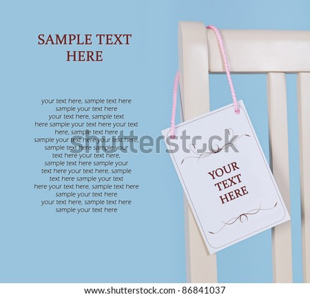 Card on the chair (with space for your text) - stock photo