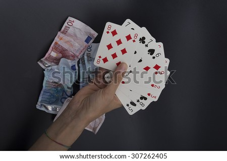 card player, waste money - stock photo
