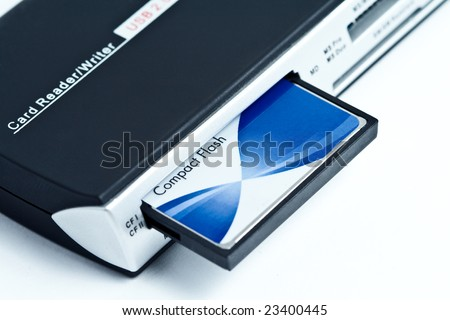 Card reader with compact flash inside on white background