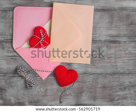 Card to Valentine's Day. Paper for text congratulations letter. Heart from red marzipan. Heart with pattern and heart sleek white wooden background. Top view. Blank space. Flat lay
