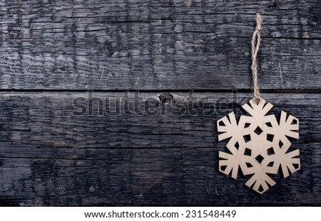 Card with  Christmas decorations  on wooden background - stock photo