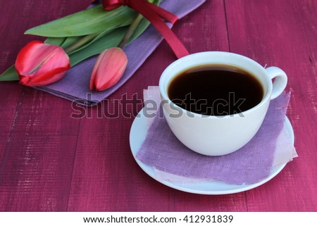 Card with cup of coffee and bouquet of red tulips. Very bright red, purple and pink color. Bright composition