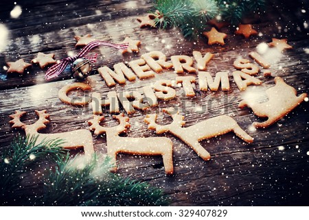 Card with Gingerbread Cookies. Baked Letters Merry Christmas, Bell, Fir Tree, Figures of Deers, Sledge, Stars. Toned - stock photo