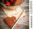 Card with Message Love You in the Letter and Chocolate Cookies in the Shape of Heart at Valentine Day - stock photo