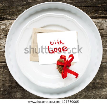 Card with Message With Love for the Breakfast on White Plates with Cookies in the Shape of Heart - stock photo