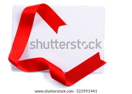 Card with red ribbon isolated on white