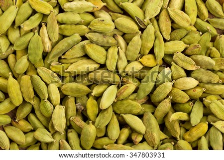 Cardamom seed pods frame filling top view background
