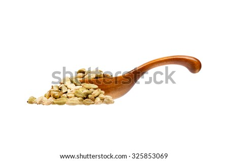 Cardamon in the wooden spoon, isolated on white background. - stock photo