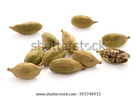 Cardamon pods isolated on white background - stock photo