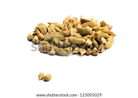 Cardamon seeds on a white background - stock photo