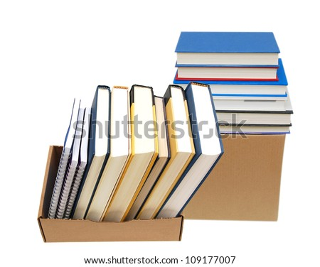 Cardboard box and books isolated on white