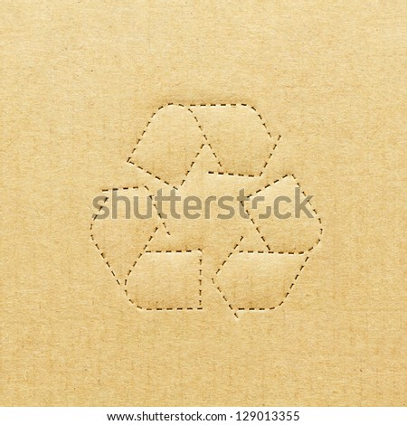 Cardboard box background with recycle symbol - stock photo