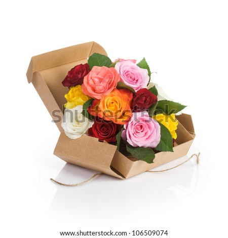 Cardboard box of fresh roses on white background