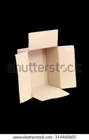 cardboard box on a black background - stock photo