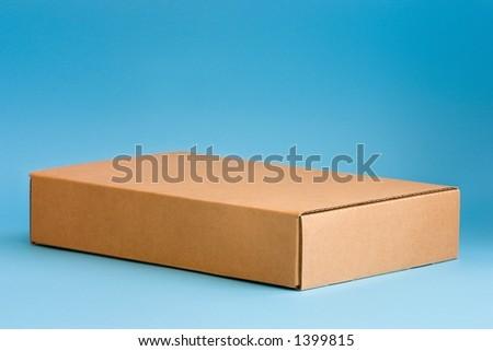 Cardboard box on blue background - stock photo