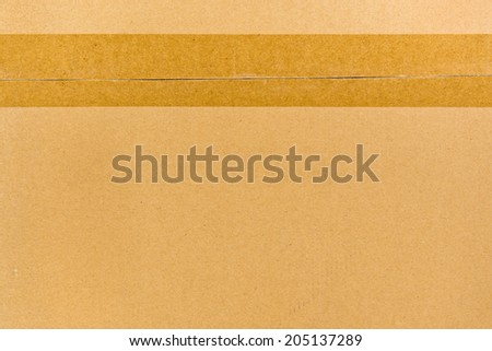 Cardboard box sealed with adhesive tape for background - stock photo