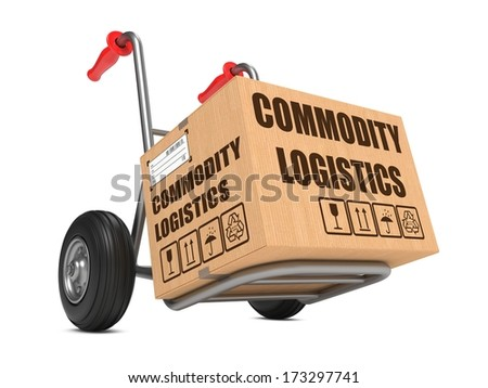 Cardboard Box with Commodity Logistics on Hand Truck White Background. - stock photo