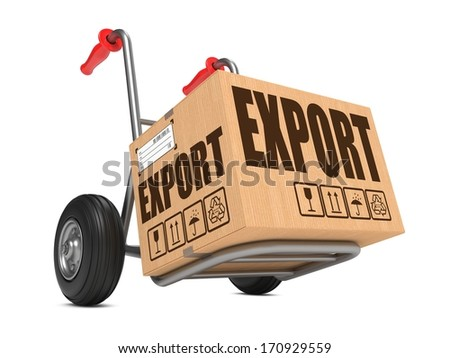 Cardboard Box with Export Slogan on Hand Truck White Background. - stock photo