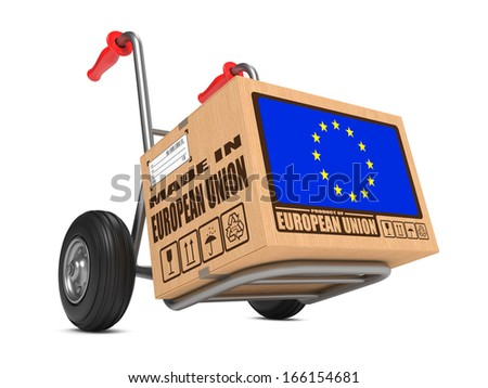 Cardboard Box with Flag of European Union and Made in European Union Slogan on Hand Truck White Background. Free Shipping Concept. - stock photo
