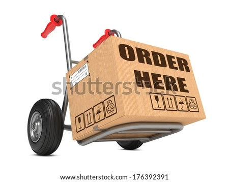 Cardboard Box with Order Here Slogan on Hand Truck Isolated on White. - stock photo
