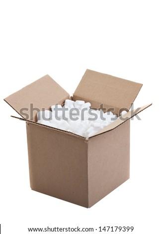 Cardboard box with styrofoam packing peanuts shot on white background. - stock photo