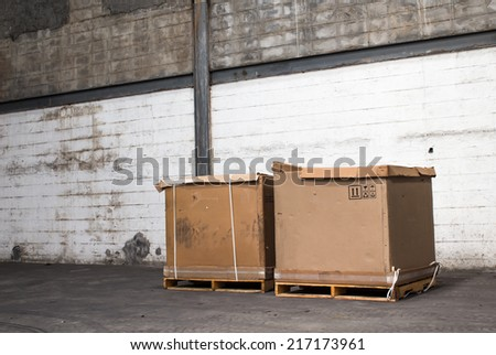 cardboard boxes in a store warehouse of automotive parts. - stock photo