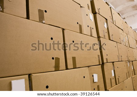cardboard boxes in the storehouse - stock photo