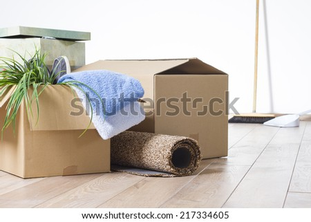 Cardboard boxes with tools on a wooden floor  - stock photo