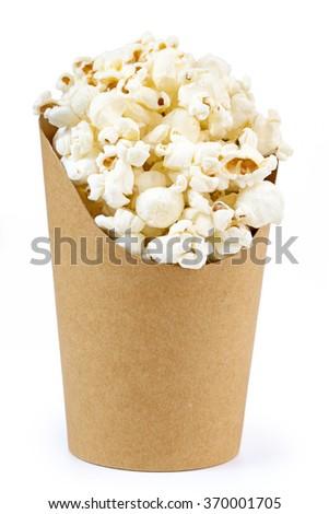 cardboard bucket full of popcorn isolated on white - stock photo