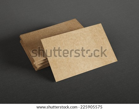 Cardboard business cards on dark background - stock photo