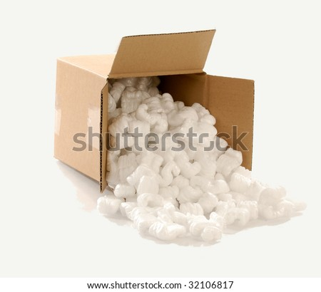 Cardboard carton filled with polystyrene foam chips - stock photo