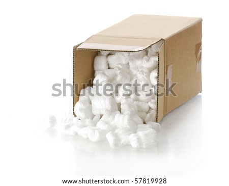 cardboard carton filled with polystyrene foam chips with reflection on white background - stock photo
