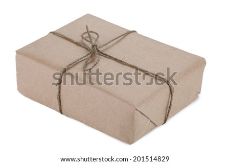 Cardboard carton wrapped with brown paper and tied with string - stock photo