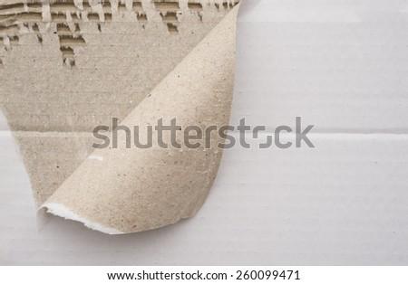 cardboard corrugated pattern with a torn corner, horizontal - stock photo