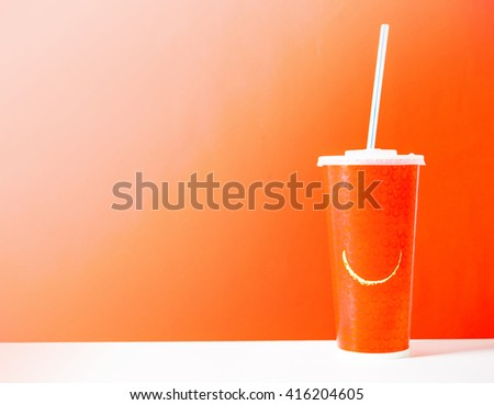 cardboard cup with a straw - stock photo