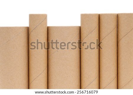 Cardboard cylinders on a white background - stock photo