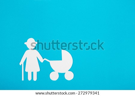 Cardboard figures of grandma and child on a blue background. The symbol of unity and happiness. - stock photo