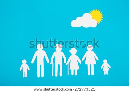 Cardboard figures of the family on a blue background. The symbol of unity and happiness.