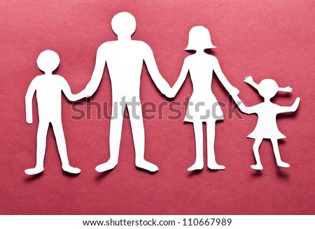 Cardboard figures of the family on a red background. The symbol of unity and happiness. - stock photo