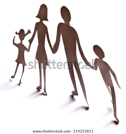 Cardboard figures of the family on a white background. The symbol of unity and happiness. - stock photo