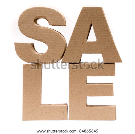 Cardboard font. SALE on white background. - stock photo