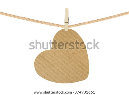 cardboard heart hang on clothespin isolated on white background - stock photo