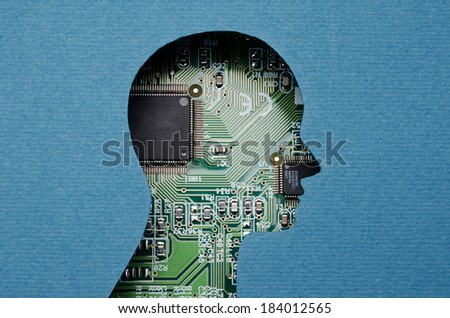 Cardboard human head cutout revealing circuit board content - stock photo