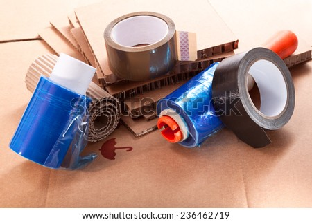 Cardboard of different thicknesses, nylon for packaging and adhesive tapes - stock photo